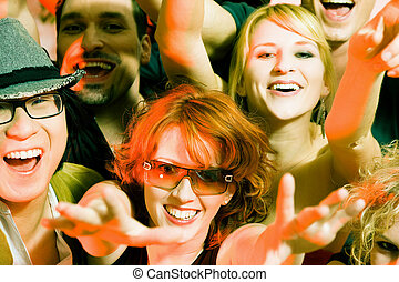 Cheering crowd in disco club - Crowd cheering - their rock...