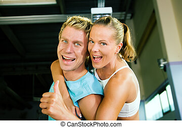Couple having fun in gym