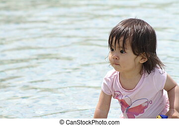 Japanese girl playing with water (1 year old)