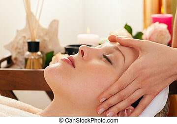 Face Massage with Spa background - Beautiful woman enjoying...