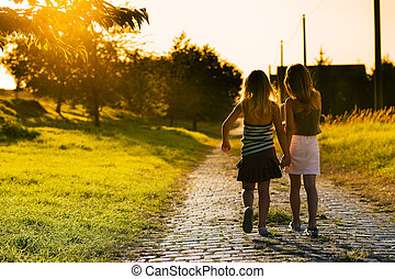 Sisters on path - Two sister children on a path leading to...
