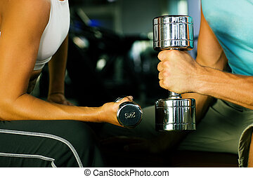 Gym workout with dumbbells