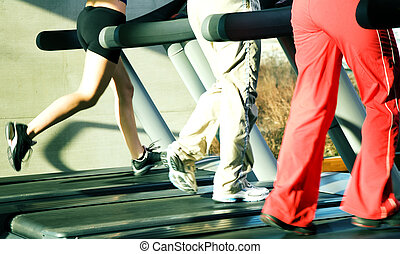 On the treadmill - People - only legs to be seen - on the...