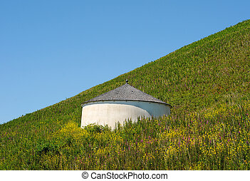 Cistern - A cistern water tower in the middle of a field on...