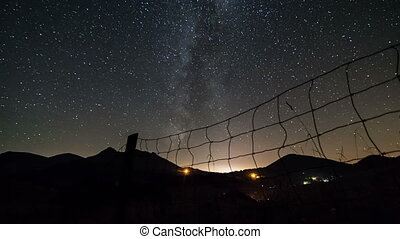 Starry night sky with milky way galaxy time lapse. Dolly...