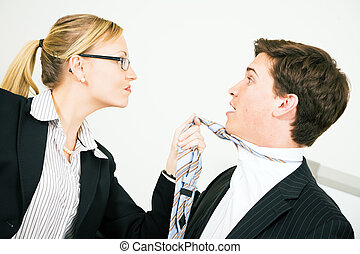 Intimidation - Businesswoman grabbing her colleague at his...