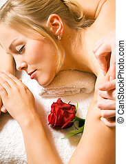 Wellness Massage - Beautiful blonde girl getting a massage...