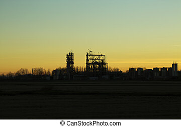 Chemical factory silhouetted at sunset