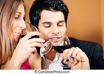 Couple having red wine - Young couple - man and woman - in a...
