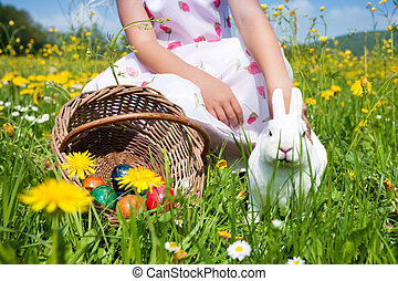 Little girl petting the Easter bunny