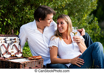 Picnic with wine in summer