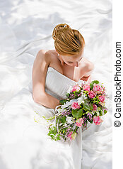 Wedding - bride - Bride sitting holding a bouquet of flowers...
