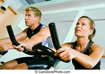 Spinning in the gym - Couple spinning in a club