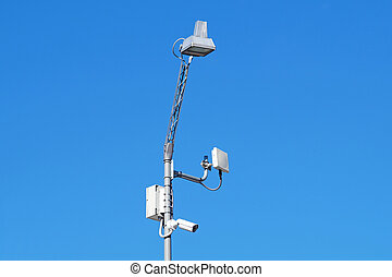 close up image of CCTV security camera fixed on a pole metalic .