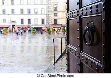 view on square in Florence city in rain