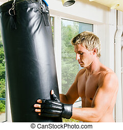 Martial Arts Training - Kickboxer preparing the sandbag