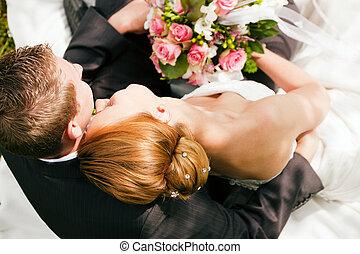 Wedding - tenderness - wedding couple hugging and kissing,...
