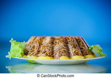 jellied meat with vegetables on a blue background