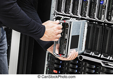 IT Technician Installing Blade Server In Chassis -...