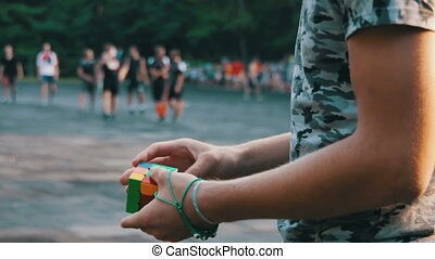 Man Collects in the Hands of the Rubik's Cube - Man quickly...