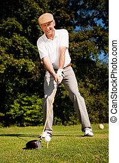Senior player golf teeing - Senior man playing golf...