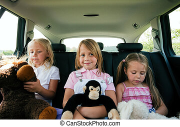 Family travelling by car - Family with three kids in a car