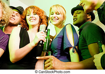 Group of friends at karaoke party - Group of friends...