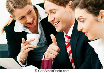Business team working in the office - Small business team -...