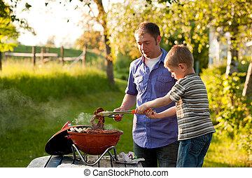 Family having barbecue in their garden
