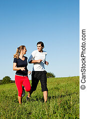 sport couple jogging outdoors in summer - Young fitness...