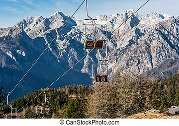 Empty ski lifts waiting for first snow. Autumn landscape at...