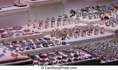 Showcase Store Jeweler Ornaments. Silver rings with precious...