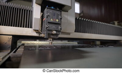 High precision CNC laser cutting metal sheet. Modern...