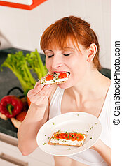 Healthy eating - woman with crispbread