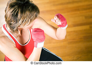 Martial Arts Sparring - Martial art pose with raised fists...