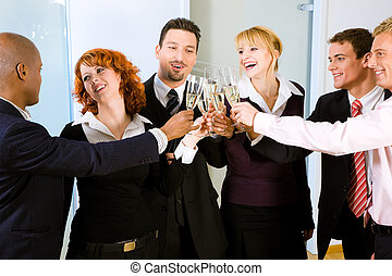 Toast with a group of people - People at a reception at the...