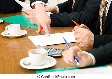 Discussing contracts - Business Team discussing documents,...