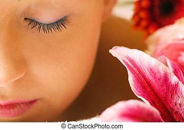 Wellness Girl - Girl with flowers in a spa situation feeling...