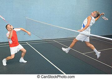 Airborne man playing badminton