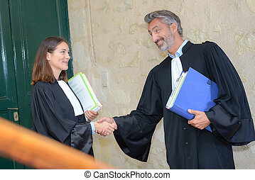 lawyers shaking hands