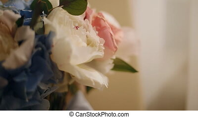 Wedding bouquet near the window. Peony, roses and hydragea...