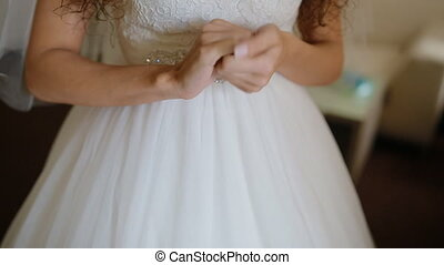 Hands of the bride waiting for her groom