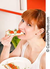 Healthy eating - woman with crispbread - Woman eating...