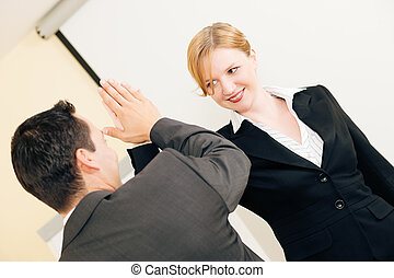 High Five for success in Business - Two people in Business...