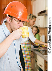 Fast coffee before starting to work - Construction worker...