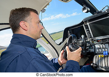 Pilot about to put on headphones