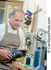 Shoe-repairer repairing a shoe
