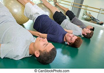 young men doing exercise