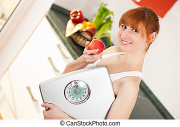 loosing weight - woman with scale and apple - Thin and...