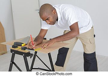 worker marking the plywood